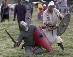 Re-enactors participate in a demonstration before a re-enactment of the the Battle of Hastings on the anniversary of the battle, in Battle, Britain October (Photo by Neil Hall/Reuters) Norman Knight, Sword Poses, Fighting Poses, Roman Britain, Sword Fight, Early Middle Ages, Medieval Armor, Fantasy Images, Dark Ages