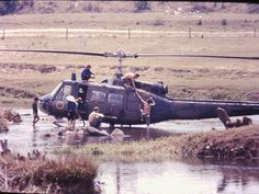 Washing a Huey Near Camp Radcliff, 1966 These guys used to land right in the little river that ran through Camp Radcliff (the 1st Air Cavalry base in An Khe Vietnam).
