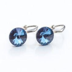 Swarovski Rivoli Earrings 8mm Denim Blue  Dimensions: length: 1,7cm stone size: 8mm Weight ~ 1,85g ( 1 pair ) Metal : sterling silver ( AG-925) Stones: Swarovski Elements 1122 SS39 Colour: Denim Blue 1 package = 1 pair