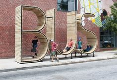A Fun, Interactive Bus Stop That Spells Out The Word 'Bus'