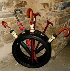 old tire umbrella stand, Creative Ways to Repurpose Old Tires, http://hative.com/creative-ways-to-repurpose-old-tires/,