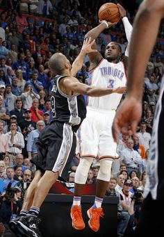 Oklahoma City's Dion Waiters (3) shoots over San Antonio's Tony Parker during an NBA  game between the Thunder and Spurs at Chesapeake Energy Arena on Wednesday. Oklahoma City won 112-106. (Photo by Bryan Terry, The Oklahoman)