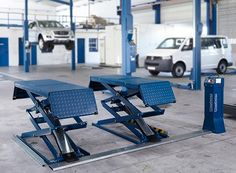 Nussbaum Jumbo 7,000 Lb Double Scissor Lift - FAST Equipment  We find better custom garage parking & storage solutions with limited space available. Let us help you discover the best, most cost-effective options for you! 800-225-7234 - Car Parking Lifts & Parking Solutions.