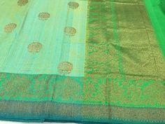 Vibrant green Banaras Dupion silk with zari border and floral butties with antiq gold zari