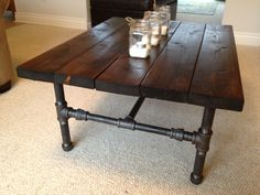 "Homemade industrial pipe coffee table using 1"" x 3/4"" steel pipe base. This is really cool."