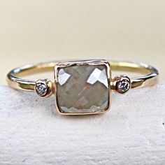 Love the simplicity, but would prefer in platinum and with a better quality diamond