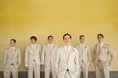 Ryan and his groomsmen donned light tan suits from Jos. A. Bank with peach ties from Men's Wearhouse
