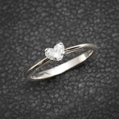 Heart shaped diamond solitaire engagement ring ♥ Stunning and dainty ♥ Center Diamond Cut: Heart cut Carat: Diamond weight 0.3ct -0.5ct Clarity VS-SI Color - G-H ♥ Choose your diamond size, all diamonds are 100% conflict free natural diamonds. in pictures the ring is set with 0.3ct . ♥ Made from 14k solid white gold, 100% recycled gold. CAN be made in White gold / Yellow gold / Rose gold. ♥ Free Jewelry Certificate + evaluation. Silly Shiny stand behind the quality a...