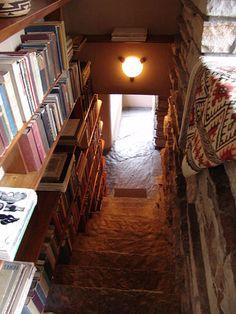 Fallingwater: third floor stair with bookshelves, Frank Lloyd Wright, architect