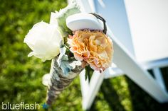 Ceremony chair decor for July wedding at Castle Hill Inn.  Photography by Blueflash Photography
