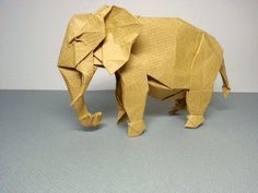 Very excellent origami elephant designed by Shuki Kato and folded by Lee Boyeon Origami Elephant, Paper Birds, Origami Animals, Elephant Design, African Elephant, Kato, Origami Paper, Dinosaur Stuffed Animal, Crafty