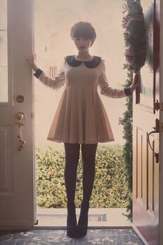 babydoll dress, tights, booties/platforms.