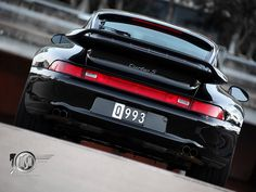 1997 black Porsche 911 993 Turbo S. Just look at that butt… phat asss