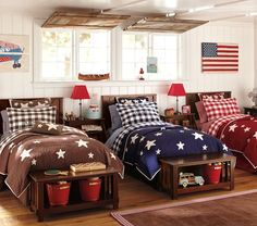 Love the Star Quilted Bedding from Pottery Barn Kids.  Can get in chocolate, navy or red.