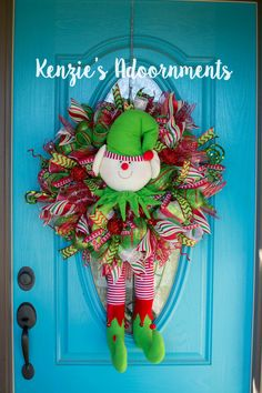 Christmas Elf Wreath, Elf Wreath, Elf Legs, Elf Legs Wreath, Whimsical Elf Wreath, Whimsical Christmas Wreath, Christmas Elf Legs Wreath by KenziesAdoornments on Etsy #christmaselfwreath #christmaself #christmaself #elflegs #whimsicalelfwreath