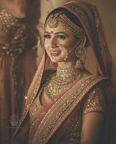 Smridhi is one of the drop-dead gorgeous bride we perfectly captured in Grand Centara , Pattaya . This Sabyasachi bride looks stunner in that flawless makeup & exquisite jewellery .We couldn't take our eyes off this gorgeous bride ! Indian Bridal Outfits, Indian Bridal Wear, Bridal Dresses, Lehanga Bridal, Red Lehanga, Eid Dresses, Asian Bridal, Bridal Nose Ring, Nath Bridal