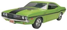 Revell 85-4213  1/25  1970 Dodge Challenger. This is a 1/25 scale '70 Dodge Challenger 2 'n 1 Plastic model kit. The kit features detailed plastic pieces molded in white, transparent red and clear. It also includes chrome plated parts, black vinyl tires, opening hood with detailed V8 engine, rear or side exhaust and optional parts for R/T or T/A versions, decals with authentic factory graphics, and illustrated instructions. Suitable for ages 10 & up. Requires Plastic cement, hobby…