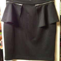 Frederick's of Hollywood - Black Skirt - Medium This fun skirt is stretchy and is made of 92% Polyester 8% Spandex.  Machine Wash Cold - Tumble Dry Low Frederick's of Hollywood Skirts Pencil