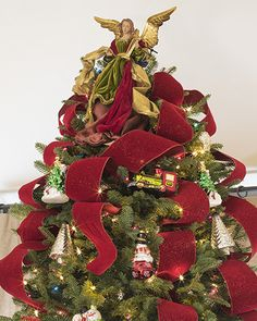 Enliven your Christmas tree display with artisanal red and burgundy ribbons from Balsam Hill.