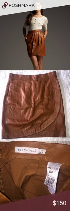 See by Chloe Wrap Brown Lambskin Leather Skirt Drop dead gorgeous cognac colored wrap See by Chloe lambskin leather skirt. You'll be feeling sexy at whether at work or if you wear this at the weekend.  Pockets!! Beautiful light brown, super soft. Fully lined. See by Chloe Skirts Pencil