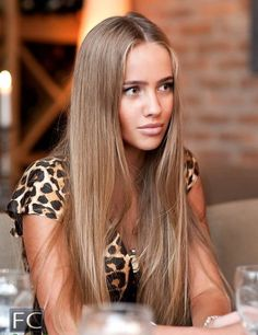 Perfect tan, hair color, and center part.
