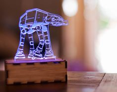 AT-AT Walker lamp, Star Wars lamp, Star Wars night light lamp, Star wars office, star wars desk accessory by lampUp on Etsy https://www.etsy.com/listing/228132300/at-at-walker-lamp-star-wars-lamp-star