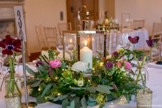 A classic winter table centre at Coombe Lodge by Bristol Florists, The Wilde Bunch. A floral ring design with Rose Gold lanterns & candles Rose Gold Lantern, Gold Lanterns, Candle Lanterns, Candles, Lodge Wedding, Wedding Table, Wedding Events, Wedding Centerpieces, Wedding Decorations