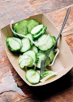 Cucumber salad, when tossed with apple cider vinegar, thinly-sliced shallots, and ground black pepper, offers a cool counter to smoked meat.
