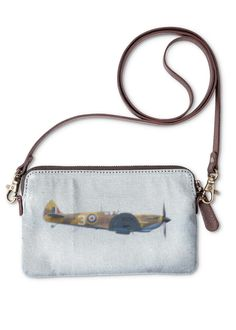 Spitfire Clutch Bag: What a beautiful product! Crafted from genuine leather and printed canvas, the VIDA Statement Clutch is a versatile standout accessory for any occasion.