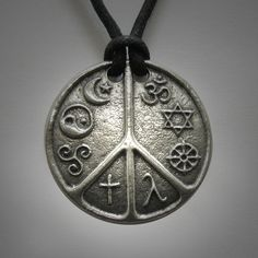 The World Peace medallion - eight religious and cultural symbols co-existing in peace...there are many paths to the same destination.
