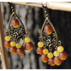 Brown and Yellow Chandeliers ($11) ❤ liked on Polyvore featuring jewelry, earrings, vintage chandelier earrings, earring jewelry, yellow earrings, brown earrings and chandelier earrings