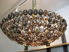 Syrenka Shell Bowl Chandelier with Antiqued Brass Finish 	 	Requires four 60-watt bulbs 	Includes canopy and three feet of chain