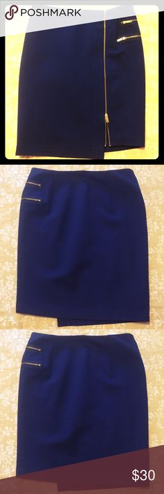 Navy skirt with zipper details Brand new asymmetrical pencil skirt with gold zipper accents. Never worn.  Amazing comfortable material.  23 inches in lengh. Skirts Pencil