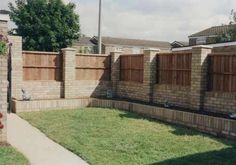 Here's a brick fence with wooden panels.