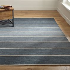 Bold Blue Striped Wool-Blend Dhurrie Rug | Crate and Barrel.  Also available in Red and Graphite.  8x10 is $649 retail / $584.10