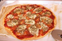 Mozzarella and cherry-tomato home-made pizza