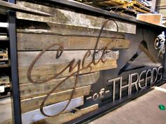 Just finished a beautiful long sign! Natural hot roll steel frame, reclaimed wood backer, aged/rusted lettering, powder-coat painted hanger, ...