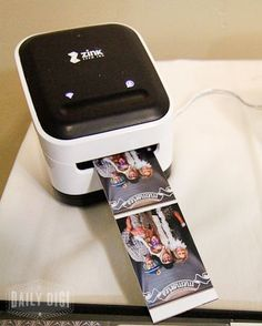 DIY Wedding Photo Booth// she uses a small smart phone picture printer which is doable but I could also include in our signage that if guests take pictures with our app then well include a print in their thank you