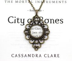Mortal Instruments 'Clary & Jace' Antique Bronze Necklace Version. I love the Mortal Instruments series, and I think this is a very pretty design of the necklace.