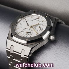 AUDEMARS PIGUET Royal Oak Dual Time - 37mm REF: 25730ST | Year 2002  The Royal Oak is a genuine design classic with over 40 years of history behind it! Housing AP's automatic cal.2349 movement with second time-zone, calendar and power reserve indication. Our watch sports the classic white tappiserie dial, signature octagonal bezel and white gold hexagonal bolts. Water resistant to 50m and equipped with a super tough sapphire crystal glass this is the ultimate cross over sports-dress watch.
