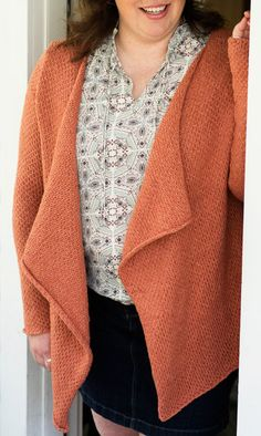 Free Knitting Pattern for 4 Row Repeat Carrington Cardigan - This long sleeved sweater withflattering draped front is knit in a 4 row repeat textured stitch. Sizes: XS[S, M, L, 1X, 2X, 3X]. Designed by Amy Palmer for Knitty