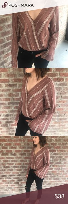 """Sisley Wrap Top- NEW! The Sisley Wrap Top with bell sleeves is the perfect addition to your wardrobe. Wear it casual with jeans or dress it up with a mini skirt.   Model is 5'5"""" wearing a size small. Fits true to size.  New product Tops Blouses"""