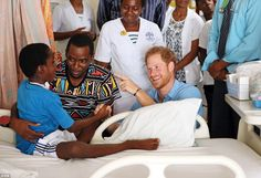 Harry chats to a youngster in the Paedriatric Ward, which his grandmother the Queen visite...