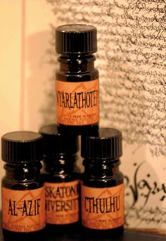 #Perfume gives the right atmosphere for the wedding #BPAL - Azathoth is the blind, idiot god who sits on a black throne at the center of Chaos. His scent is high-pitched and screeching, both impenetrably dark and searingly bright with the clarity of madness: tangerine, saffron, vetiver, black amber and cedarwood. #octopus #wedding #Cthulhu