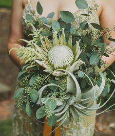King Protea and Air Plants | 20 Unexpected Wedding Flower Ideas | https://www.theknot.com/content/unique-wedding-flower-ideas