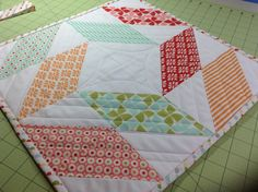 Half square triangle table runner from half square triangles from camille roskelley craftsy class.  For bunko