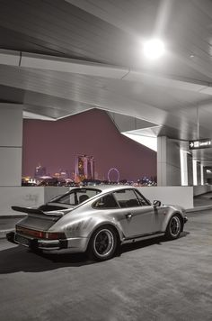1977 Porsche 911 turbo 3.0 with 'turbo side stripes decal' factory option. Singapore's Marina Bay skyline in the background.
