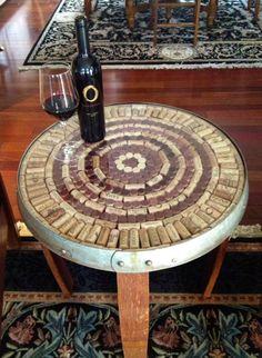 This wine barrel stave accent table allows you display your cork collection or other small collectibles.