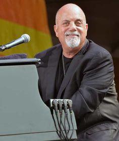 Billy Joel performs during the 2013 New Orleans Jazz & Heritage Music Festival at #FairGroundsRaceCourse on April 27, 2013 in New Orleans