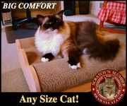 Ultimate Cat Scratch Loungers by Brawny Cat - Big Comfort for Any Size Cat...and has lasting cardboard scratching surface available/reverse sided!! One of product design finalist in Apartment Therapy 2011 Design Showcase too!